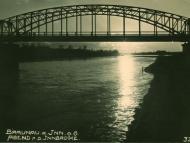 Ansichtskarte mit Sonnenuntergang an der Innbrücke