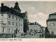 Ansicht der im Dritten Reich umbenannten Innstraße zwischen Stadt-Apotheke und Kaufhaus Mühldorfer